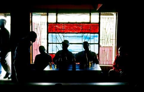 Men drink in an illegal bar in Khayelitsha, South Africa